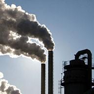 Smoking chimneys against blue sky