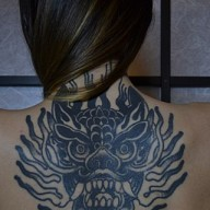 Tattoo on the back of a woman